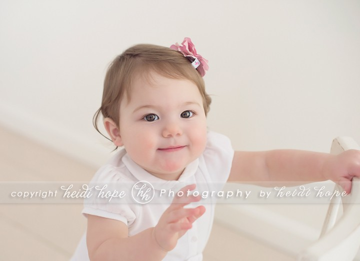 One year old smiling up in cream - Heidi Hope