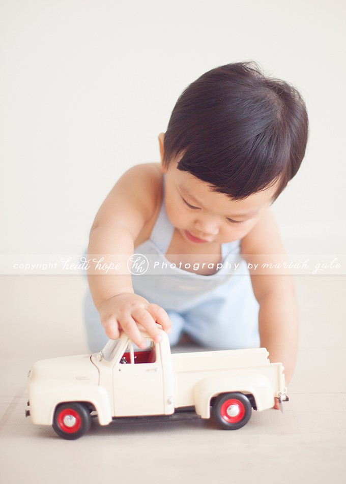 9 month old boy playing with antique car - Rhode Island Baby Photographer
