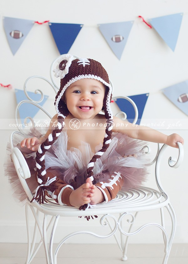 Baby girl in football hat and set
