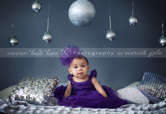 Heidi Hope - baby girl in purple dress sitting around glitter girly set