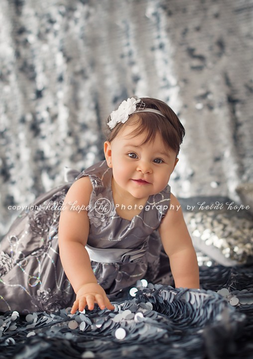Heidi Hope Photography - One year old girl in glitter sequin back drop