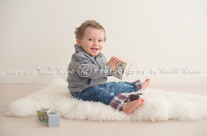 Heidi Hope - One year old boy playing with blocks