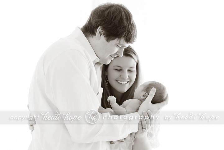 Family with newborn black and white