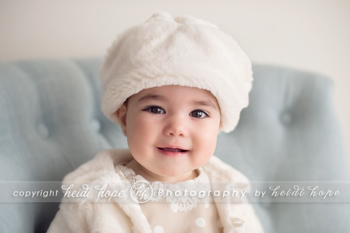 6 month old girl wear white furry hat and coat - Boston Photographer