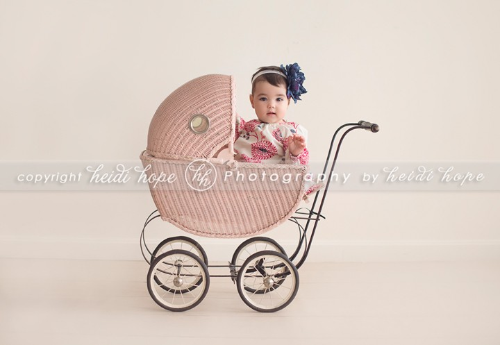 Baby 6 month old sitting in carriage - New England baby photography