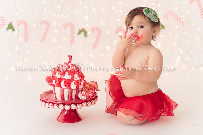 Girl cake smash holiday themed with red and white candy canes - Heidi Hope
