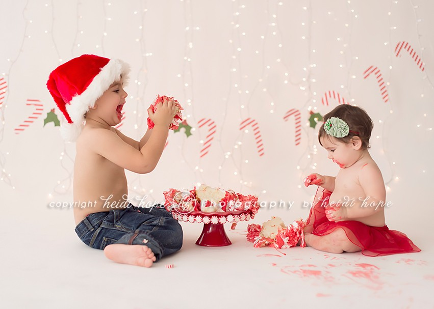 Heidi Hope - Litte boy and girl holiday cake smash with santa hat and candy canes