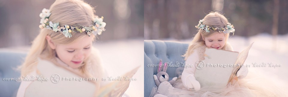 Blonde girl with blue flowered headband in snowy woods reading book