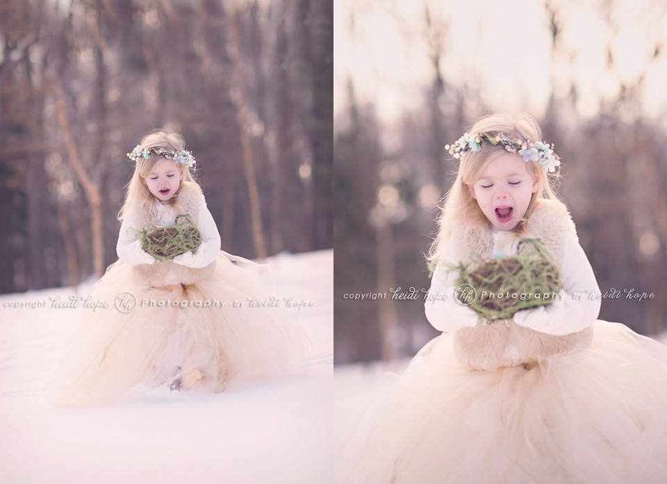 Girl in snowy woods in large tutu holding nest