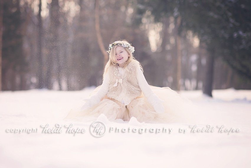 Girl playing in snow in large tutu