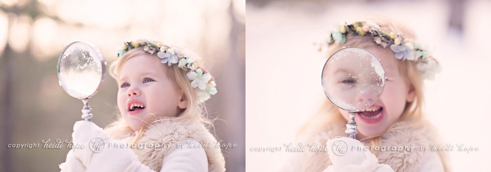 Girl with flowered headband playing with magnifying glass