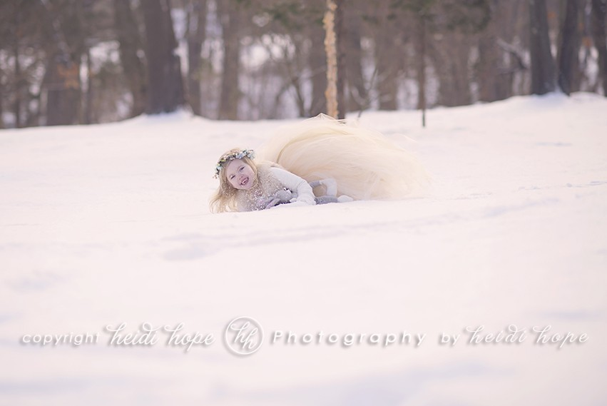 Girl in tutu playing in the snow