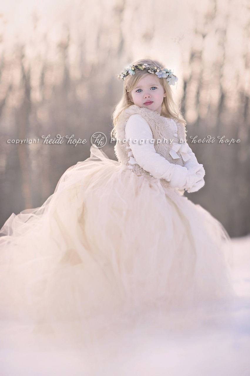 Girl in tutu standing in the snow