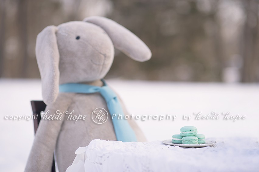 Bunny wearing tie at snowy tea party