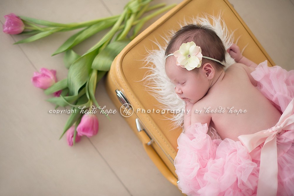 newborn and flowers