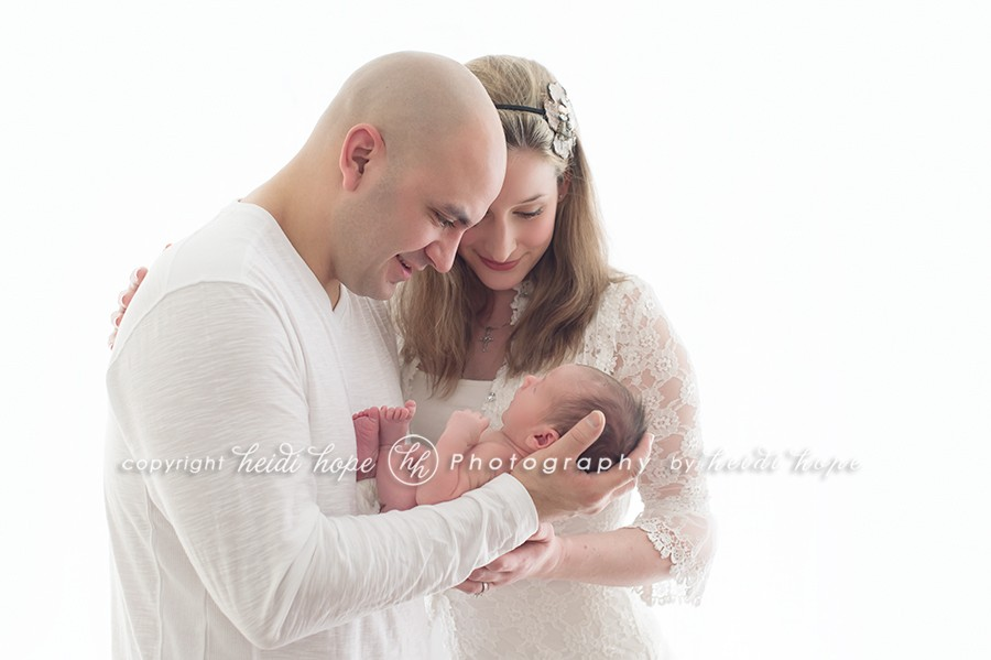 newborn with parents by heidi hope photography