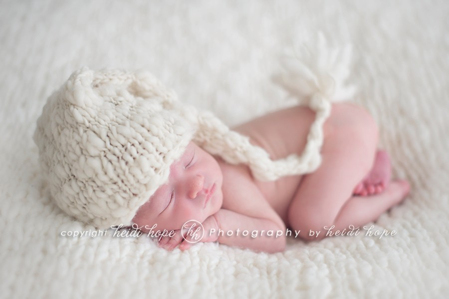 newborn with knit hat by heidi hope photography